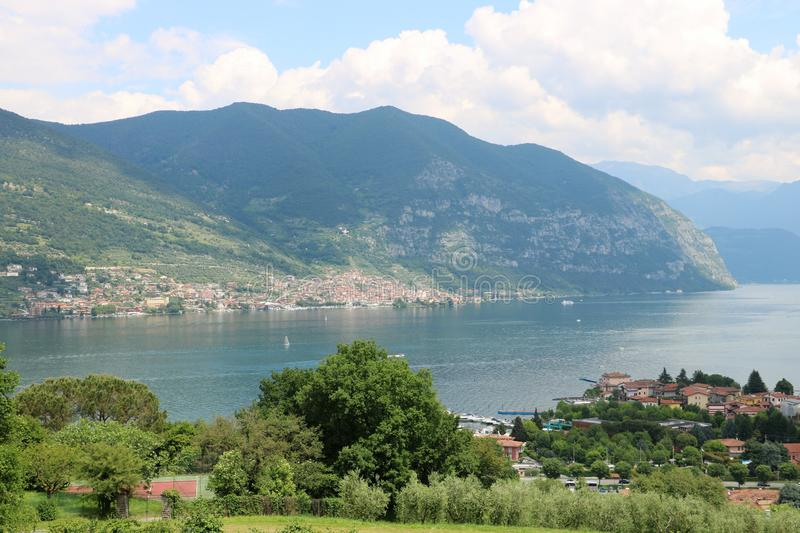 Lake Iseo, Italy. View on the southern end of lake Iseo, the fourth largest lake in Lombardy, Italy. There are several medieval towns around the lake, the stock photos