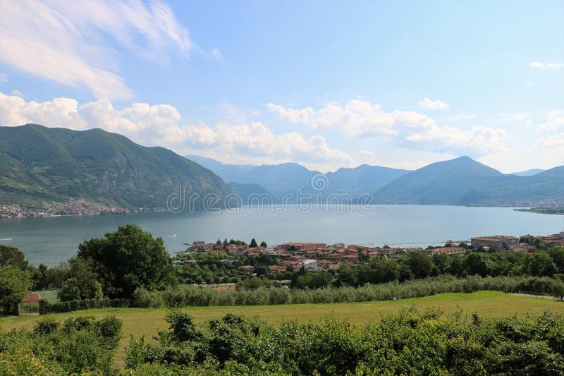 Lake Iseo, Italy. View on the southern end of lake Iseo, the fourth largest lake in Lombardy, Italy. There are several medieval towns around the lake, the stock photography