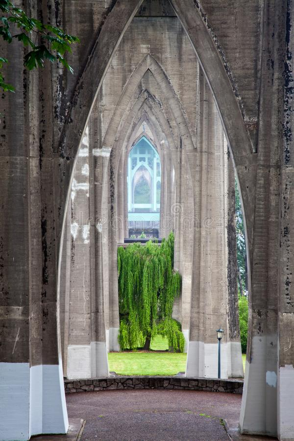 View southwest underneath the St. Johns Bridge and across Cathedral Park in Portland, Oregon, USA stock photography