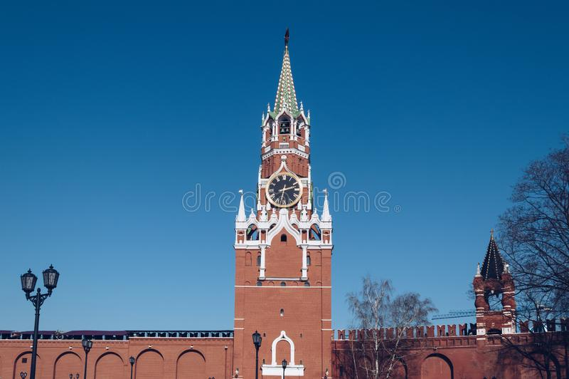 View of Spasskaya tower with blue sky on bg royalty free stock photography
