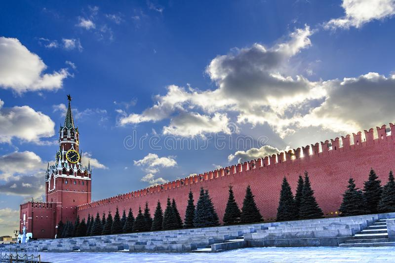View of the Spasskaya Tower and the wall of the Moscow Kremlin on a sunny day in late autumn against the blue sky. Moscow, Russia. royalty free stock images