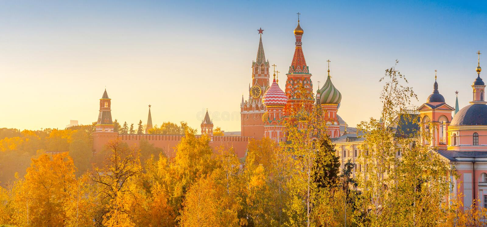 View of St. Basil`s Cathedral and Spassky Tower on Red Square at bright sunset, autumn evening stock photography