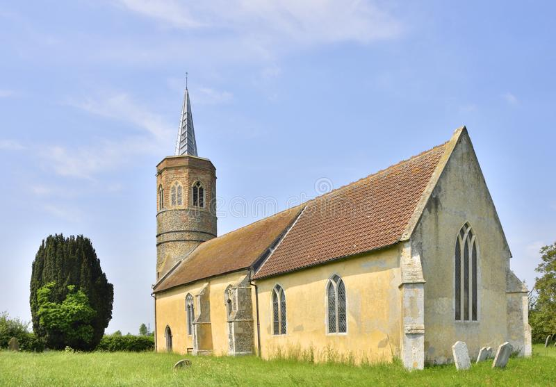 Historic English Medieval Church with Victorian Spire. View of St George`s, Shimpling, an historic English church with octagonal tower top, Norfolk, England royalty free stock photos