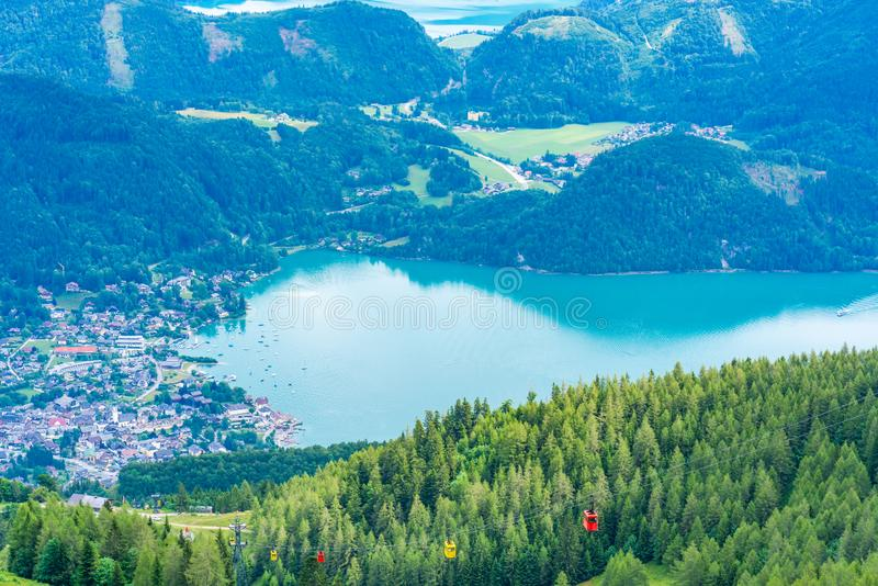 View of St.Gilgen village, Wolfgangsee lake and surrounding mountains from Zwolferhorn mountain. In Salzkammergut region, Austria stock photography