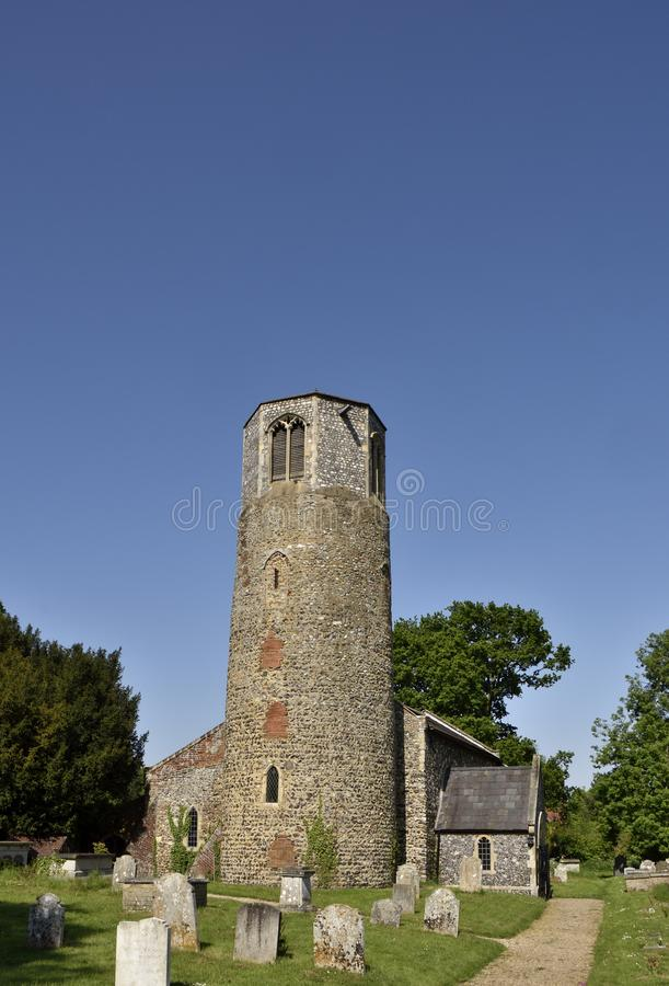 Historic Church of East Anglia. View of St. Mary`s church, Surlingham, showing c. 13th century round tower with added c. 15th century octagonal belfry, South stock image