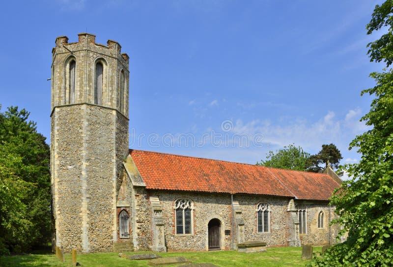 Historic English Octagonal Tower Church. View of St Nicholas` Church, Buckenham, an historic English church with octagonal tower, Norfolk, England stock photo