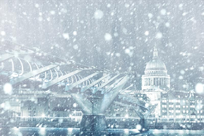 View of St. Paul Cathedral and Millennium Bridge in London with snow. View of St. Paul Cathedral and Millennium Bridge in London by night with snow stock photography