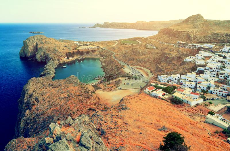 View of St. Paul´s bay, Lindos village and Mediterranean Sea from acropolis of Lindos Rhodes, Greece stock image