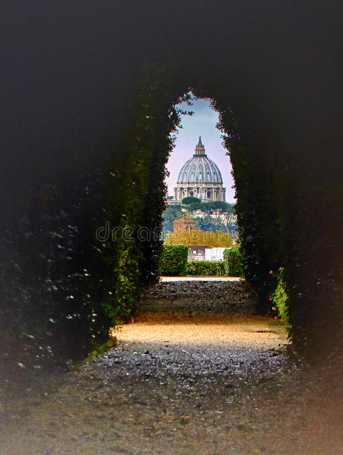 View of St Peter`s Basilica. As seen through the Aventine Keyhole. Rome royalty free stock images