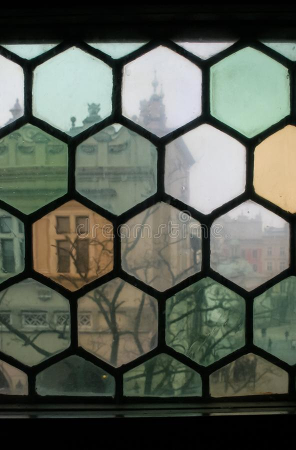View through a Stained Glass Window to an Old City in Krakow, Poland stock photos