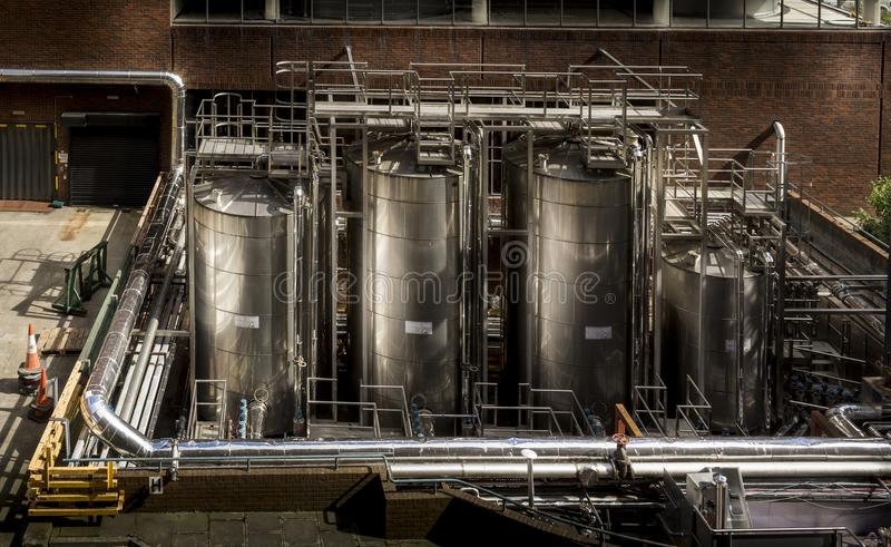 Stainless steel tanks in industrial environment royalty free stock images