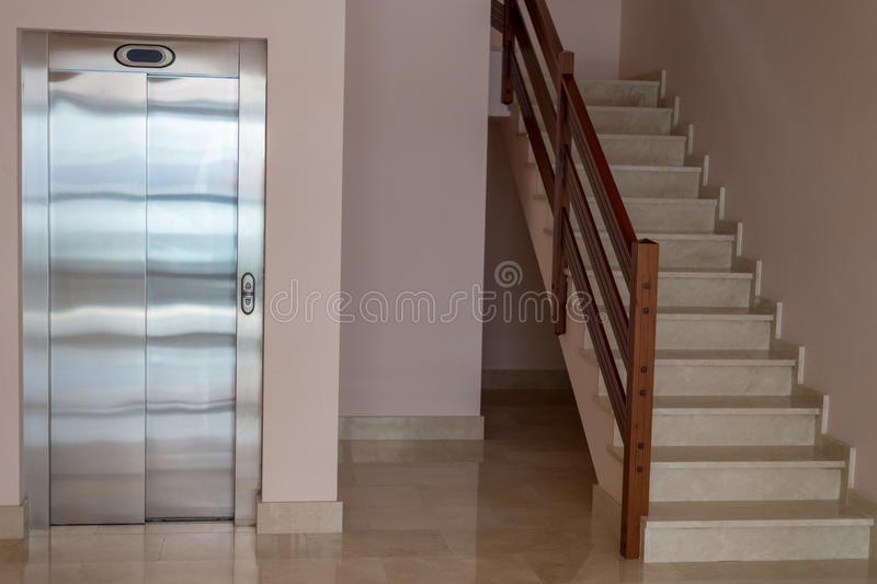 View of the staircase with elevator in apartment house stock image