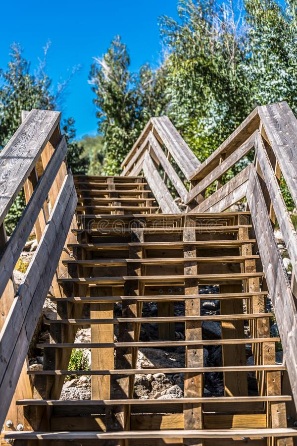 View of a stairs on wooden suspended pedestrian walkway on mountains, overlooking the Paiva river. In Arouca, Portugal royalty free stock image