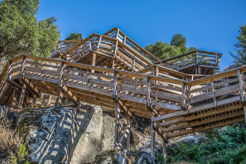 View of a stairs on wooden suspended pedestrian walkway on mountains, overlooking the Paiva river. In Arouca, Portugal stock image