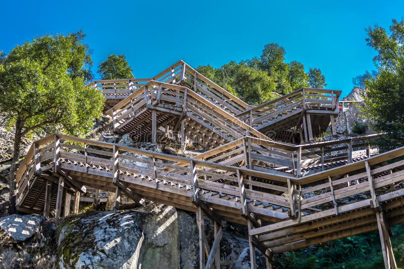View of a stairs on wooden suspended pedestrian walkway on mountains. Overlooking the Paiva river, in Arouca, Portugal stock images