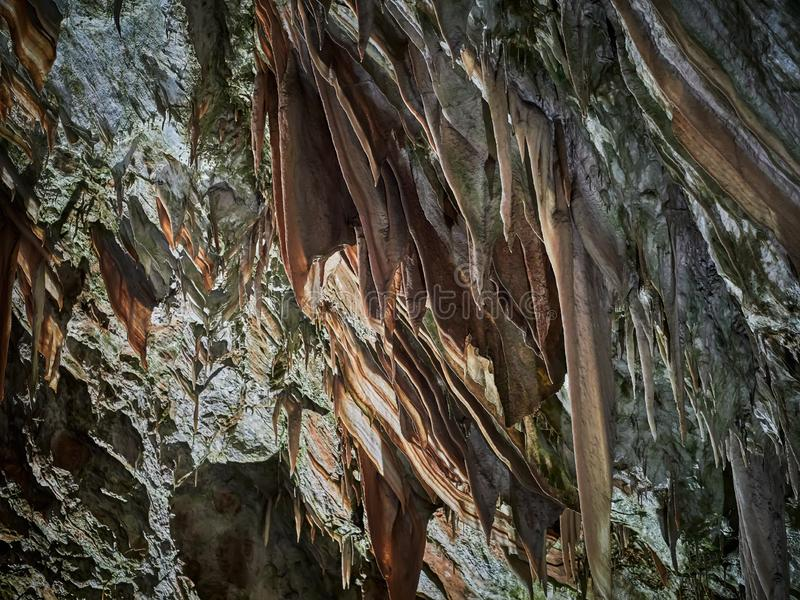 View of stalactites and stalagmites in an underground cavern - Postojna cave in Slovenia.  royalty free stock images