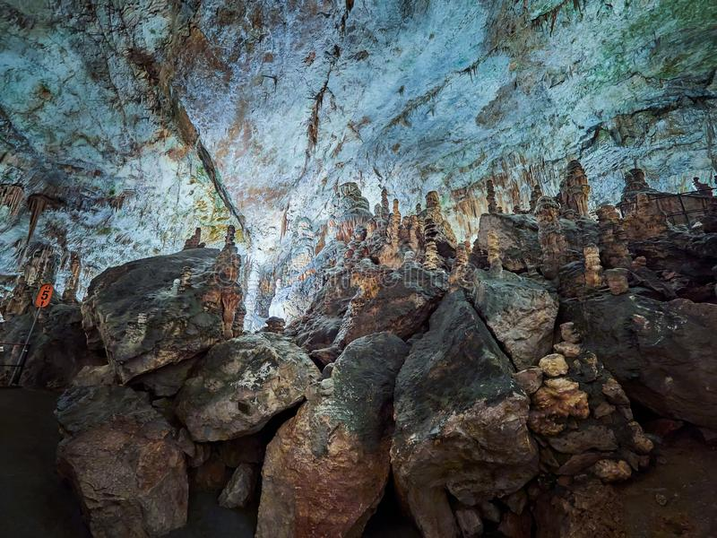 View of stalactites and stalagmites in an underground cavern - Postojna cave in Slovenia.  royalty free stock image