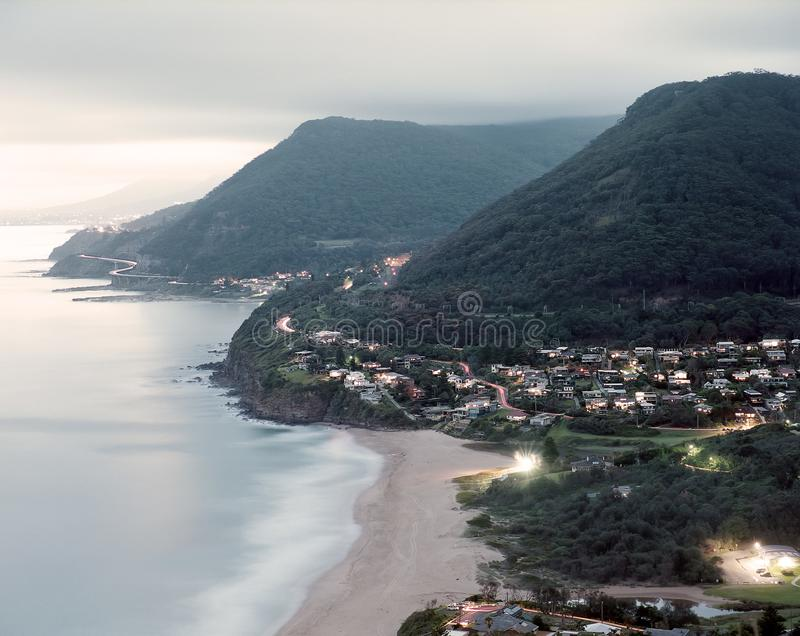 Stanwell Park Illawarra New South Wales NSW Australia at dusk with city lights colour royalty free stock images