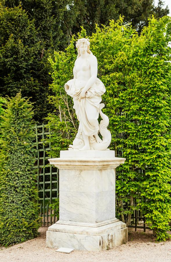 Statue Water by Pierre Le Gros. Park of the Palace Versailles. View of Statue Water by Pierre Le Gros. Park of the Palace Versailles royalty free stock images