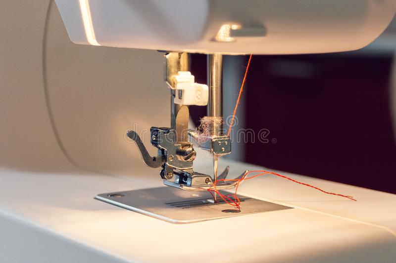 View of steel needle of the sewing machine. View of steel needle of the white electric sewing machine prepared for sew royalty free stock photo