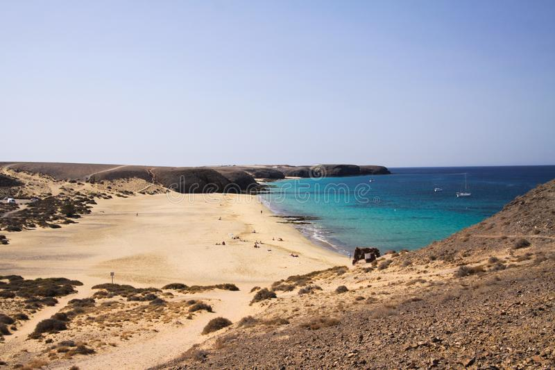 View from steep cliff into blue lagoon beach - Playa Papagayo, Playa Blanca - Lanzarote stock photography