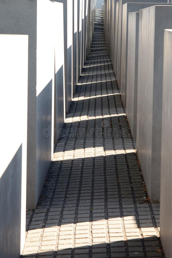 A view between the stelae. Memorial to the Murdered Jews of Europe. Berlin. Germany. Berlin is the capital and largest city of Germany; the Memorial to the royalty free stock images