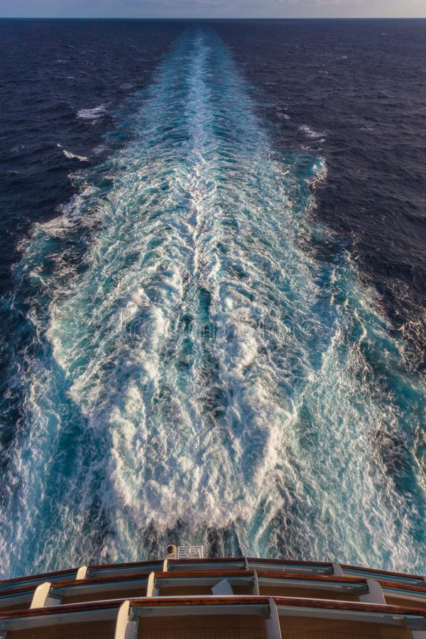 View of the stern of a cruise ship and the foam wake left by the propellers. Mediterranean sea stock photo