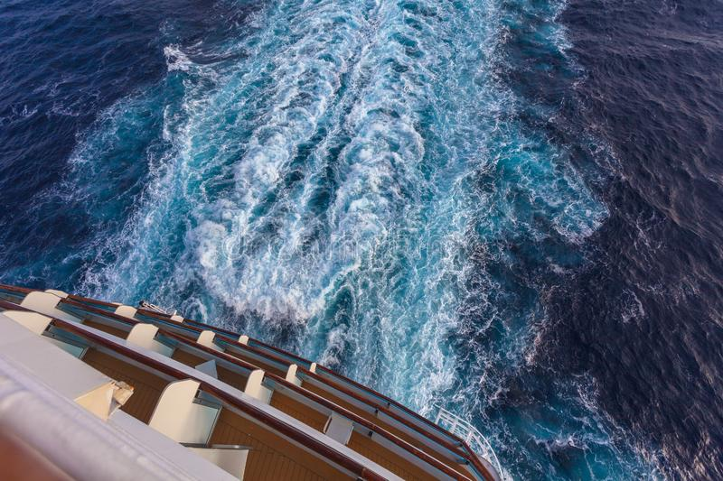 View of the stern of a cruise ship and the wake left by the propellers. Mediterranean sea royalty free stock photos