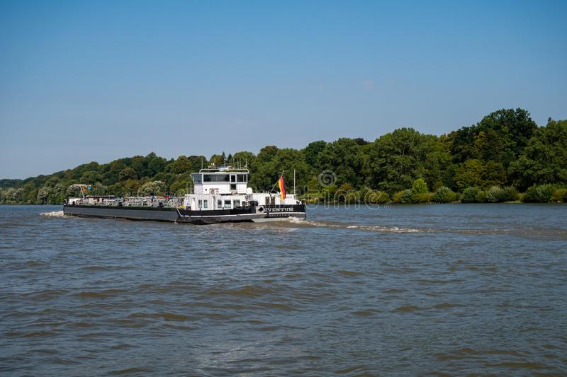 View at stern of tankship Eventum driving on the Elbe River stock photo