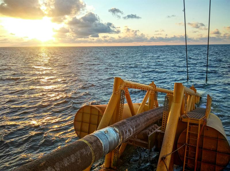 View of stingers during sunset on board pipelines barges at offshore sarawak. Pipeline installation project is an offshore installation project where pipes are royalty free stock images