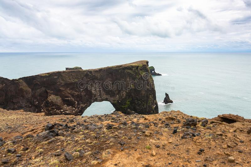 view stone arch on Dyrholaey promontory in Iceland royalty free stock images