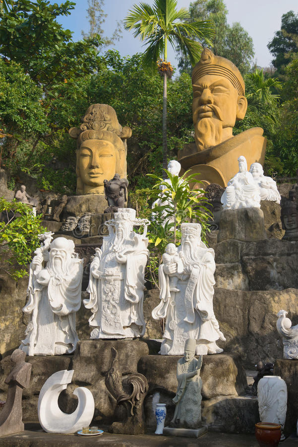 View of the stone sculptures at the foot of the Marble mountains. Da Nang, Vietnam. DA NANG, VIETNAM - JANUARY 05, 2016: View of the stone sculptures at the foot royalty free stock photo