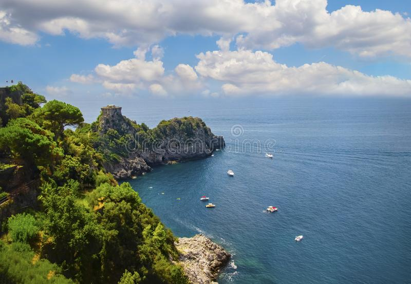 The view of stone tower on the Amalfi coast. This is on the south of Italy in Europe. The city stands on cliffs above the sea. stock image