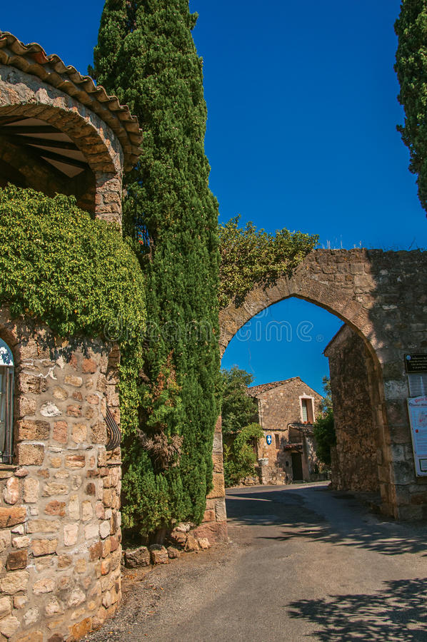 View of stone wall and arch at the entrance of Les Arcs-sur-Argens stock photos