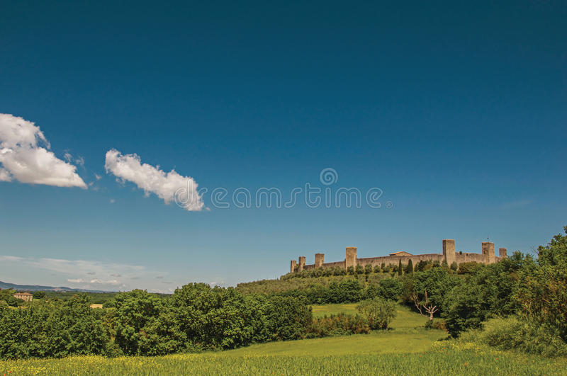 View of the stone walls of the hamlet of Monteriggioni on top of hill. royalty free stock images