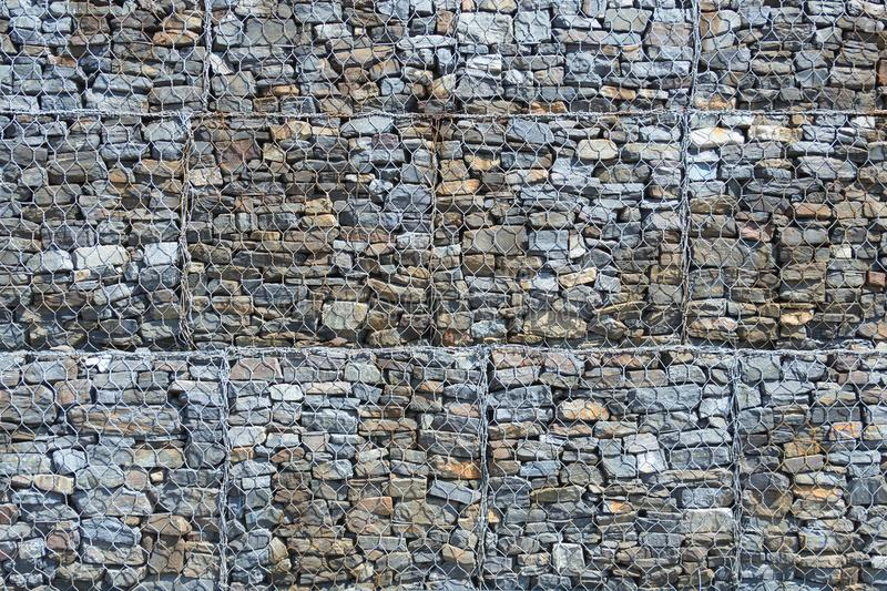 Stones in steel mesh cage as texture royalty free stock image