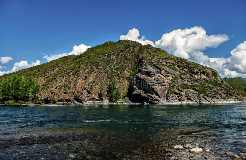 View from the stony shore of the mountain river. View from the stony shore the mountain river stock photo