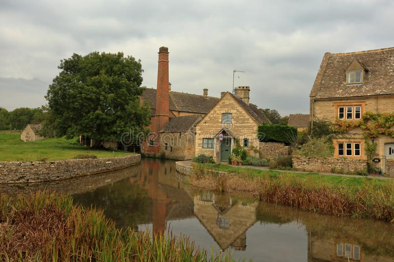 Lower Slaughter village view. A view of the stream and buildings in the Gloucestershire Cotswolds village of Lower Slaughter royalty free stock photos