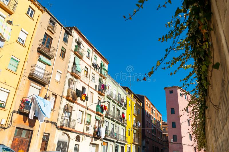 View of street with colorful houses in small catalan spanish medieval town during sunny spring day and clear blue sky. Small town colorful street in spring stock photos