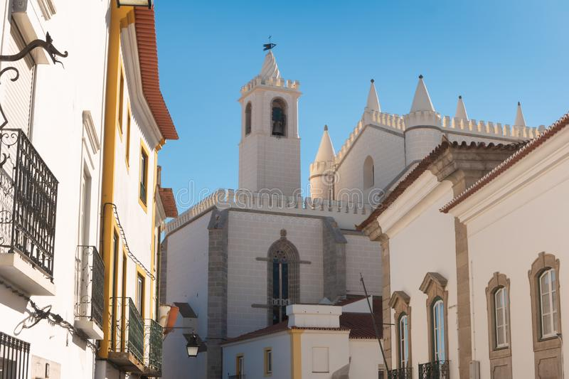 The view of street of Evora with the cozy white and yellow houses. Evora. Alentejo. Portugal stock photos