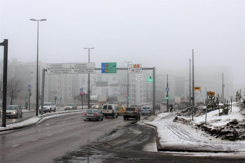 Helsinki, Finland, March 2012. View of the street with heavy traffic near the seaport. stock photography