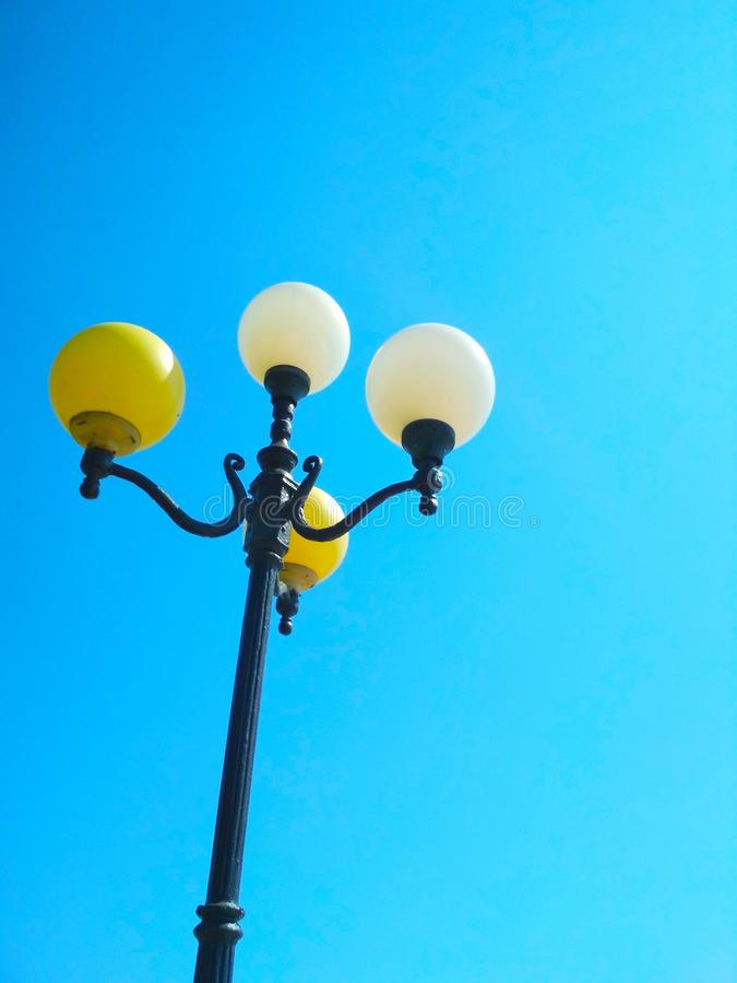 Street light, architectural decision. View of a street light against the background of the blue cloudless sky stock photos