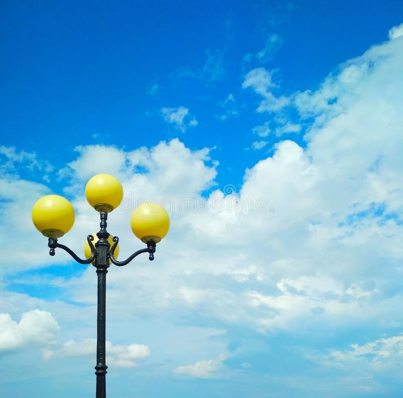 Street light, architectural decision. View of a street light against the background of the blue cloudy sky royalty free stock photos