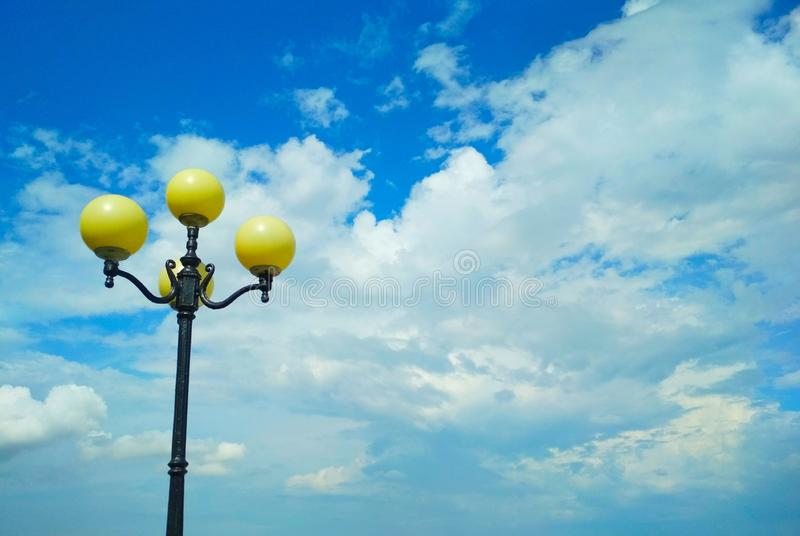 Street light, architectural decision. View of a street light against the background of the blue cloudy sky royalty free stock photography