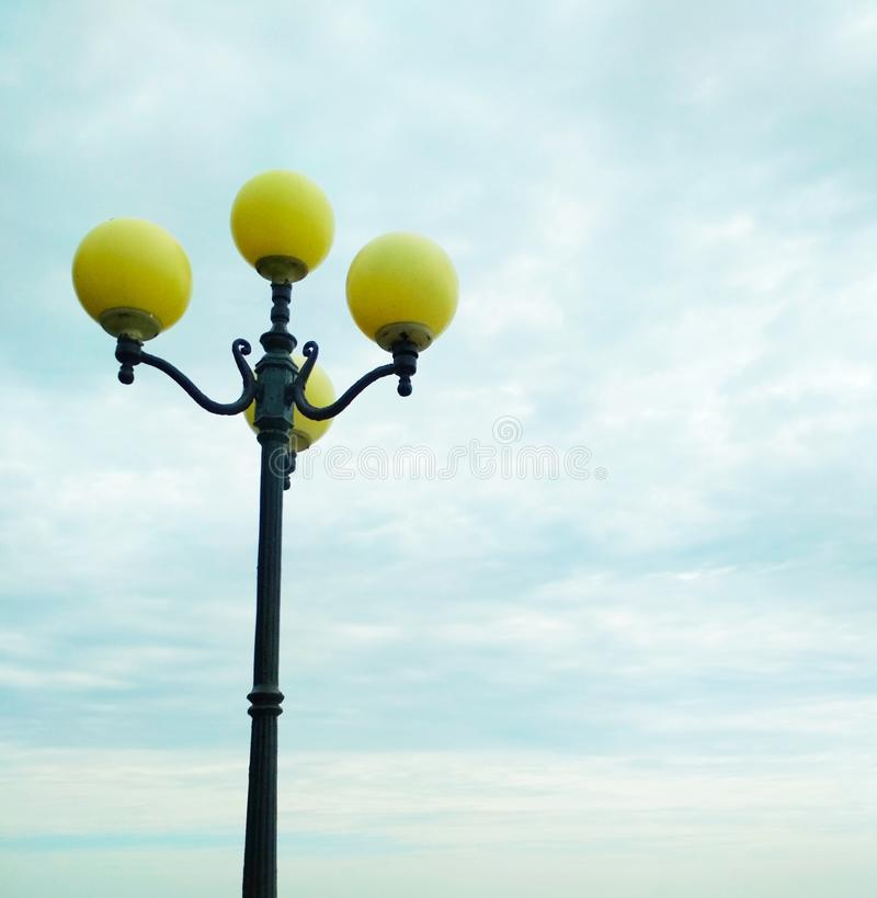Street light, architectural decision. View of a street light against the background of the sky covered with clouds stock photo