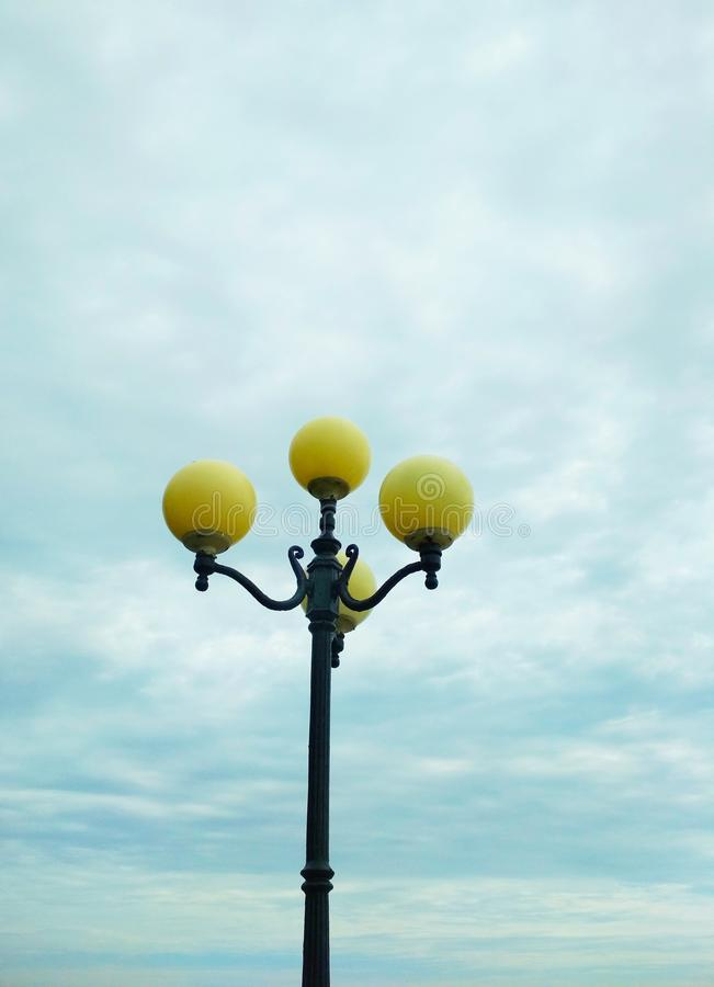 Street light, architectural decision. View of a street light against the background of the sky covered with clouds royalty free stock photos