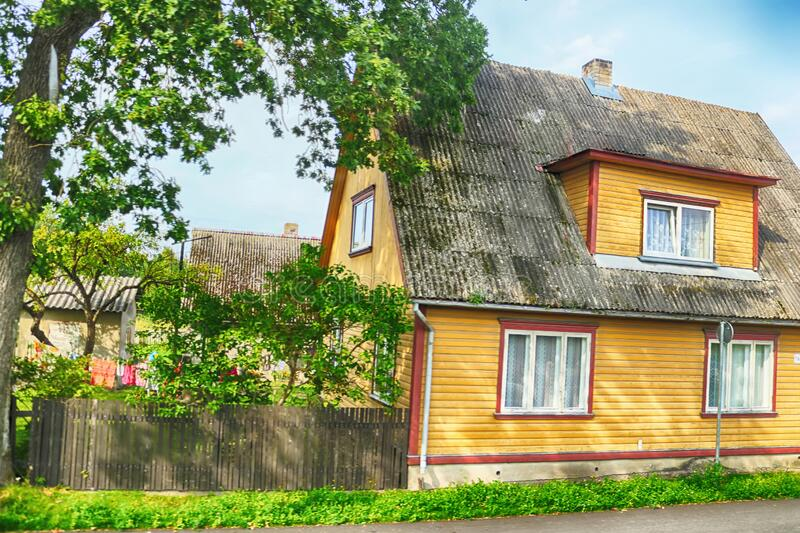 View of street with old wooden house in Parnu, Estonia. Europe stock photo