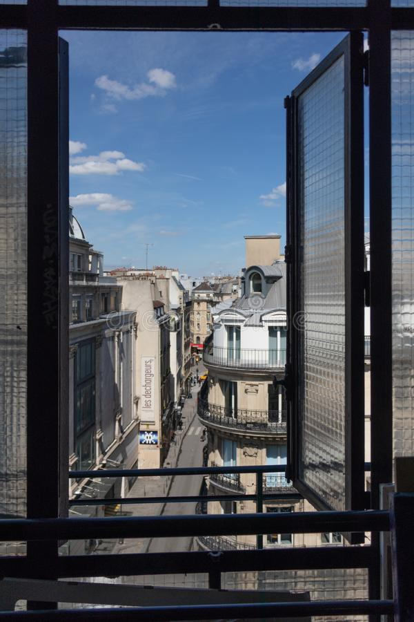 A view on a street of Paris thru the attic window stock photo