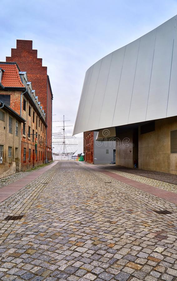 View through the streets of the old town in Stralsund on a large sailing ship in the harbor royalty free stock photo