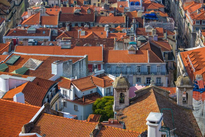 View of the streets and the orange roofs of the old town. Lisbon, Portugal. View from above. View from the walls of the castle royalty free stock image